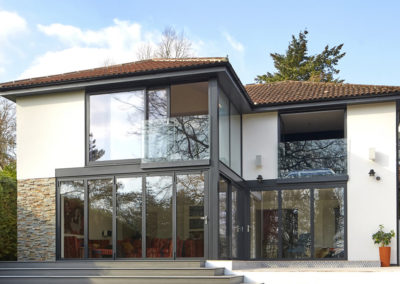 1970s property transformation creates interest and opens it up to stunning views